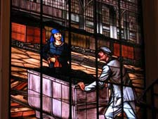 the work of miners in a stained glass window